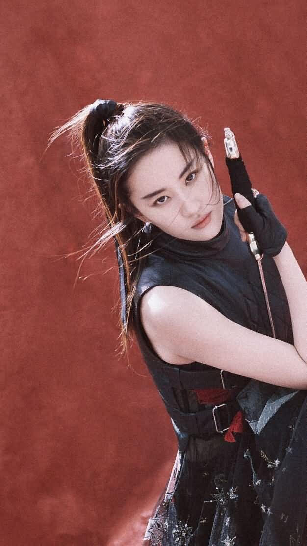 柳宗源年初拍的一组图,桃林里的侠女,侠骨柔情